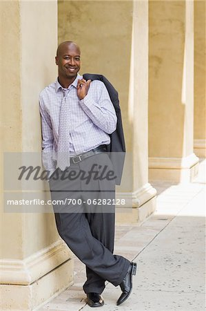 Portrait of Businessman Leaving Against Column Stock Photo - Rights-Managed, Image code: 700-06282128