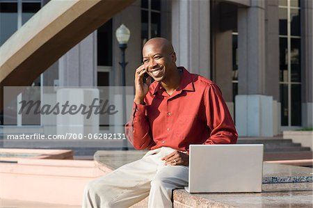 Man with Laptop and Cell Phone Stock Photo - Rights-Managed, Image code: 700-06282131