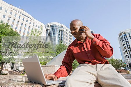 Businessman with Laptop and Cell Phone Stock Photo - Rights-Managed, Image code: 700-06282136