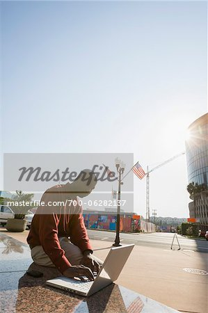 Businessman with Laptop and Bright Sun Stock Photo - Rights-Managed, Image code: 700-06282137