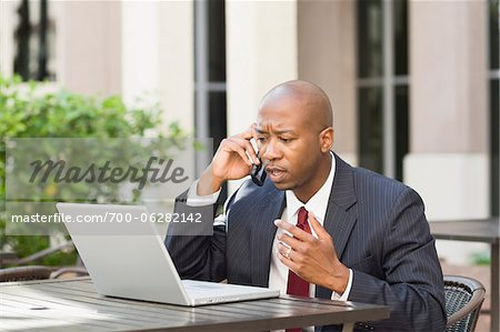 Businessman with Laptop and Cell Phone Stock Photo - Rights-Managed, Image code: 700-06282142