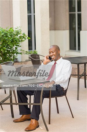 Businessman with Laptop and Cell Phone Stock Photo - Rights-Managed, Image code: 700-06282145
