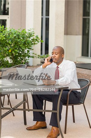 Businessman with Laptop and Cell Phone Stock Photo - Rights-Managed, Image code: 700-06282146