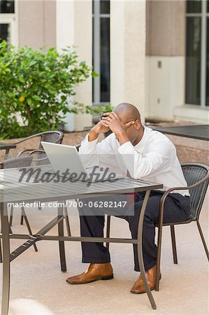 Businessman with Head in Hands Stock Photo - Rights-Managed, Image code: 700-06282147