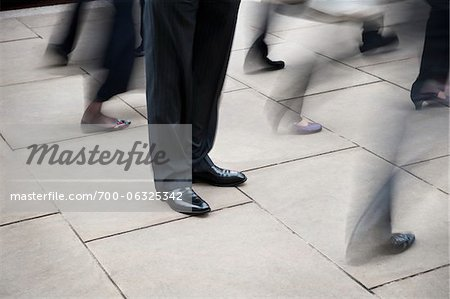 Businessman Standing Still Amongst Pedestrian Traffic Stock Photo - Rights-Managed, Image code: 700-06325342