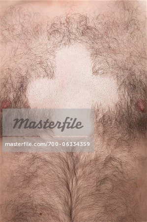 Bare Cross Shape in Man's Chest Hair Stock Photo - Rights-Managed, Image code: 700-06334359