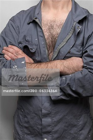 Close-Up of Man Wearing Coveralls Stock Photo - Rights-Managed, Image code: 700-06334364