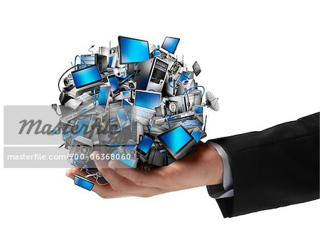 Clos-Uup of Businessman Holding Ball of Electronics Stock Photo - Rights-Managed, Image code: 700-06368060