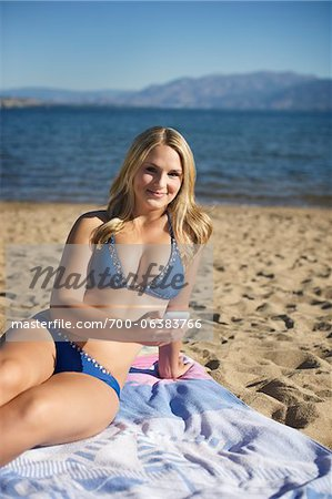 Young Woman with Cell Phone on Beach Stock Photo - Rights-Managed, Image code: 700-06383766