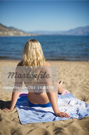 Rear View of Woman on Beach Stock Photo - Rights-Managed, Image code: 700-06383778
