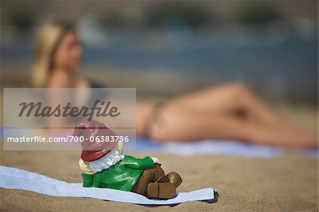 Garden Gnome on Beach Looking at Woman Stock Photo - Rights-Managed, Image code: 700-06383796
