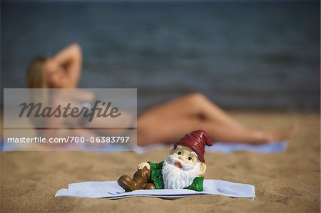 Garden Gnome Posing on Beach Stock Photo - Rights-Managed, Image code: 700-06383797