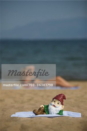 Garden Gnome Posing on Beach Stock Photo - Rights-Managed, Image code: 700-06383798