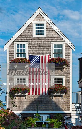 Historic Fisherman's Shingle House Draped with American Flag, Provincetown, Cape Cod, Massachusetts, USA Stock Photo - Rights-Managed, Image code: 700-06431211
