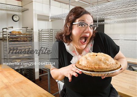 Woman with Excited Facial Expression Holding Apple Pie in Bakery Kitchen Stock Photo - Rights-Managed, Image code: 700-06431314