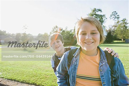 Portrait of Two Boys Standing Outdoors in Neighbourhood Area Stock Photo - Rights-Managed, Image code: 700-06439144