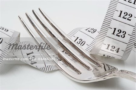 Close-Up of Fork Lying on top of Measuring Tape Stock Photo - Rights-Managed, Image code: 700-06465381
