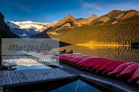 Red Canoes on Dock at Dawn, Lake Louise, Banff National Park, Alberta, Canada Stock Photo - Rights-Managed, Image code: 700-06465426