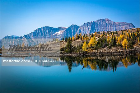 Rock Isle Lake with Autumn Larch and Mountain Range in Background, Mount Assiniboine Provincial Park, British Columbia, Canada Stock Photo - Rights-Managed, Image code: 700-06465477
