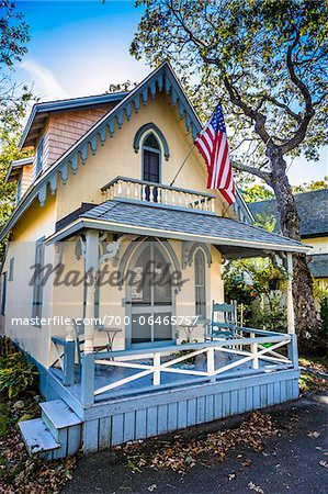 House with Porch and American Flag, Wesleyan Grove, Camp Meeting Association Historical Area, Oak Bluffs, Martha's Vineyard, Massachusetts, USA Stock Photo - Rights-Managed, Image code: 700-06465757