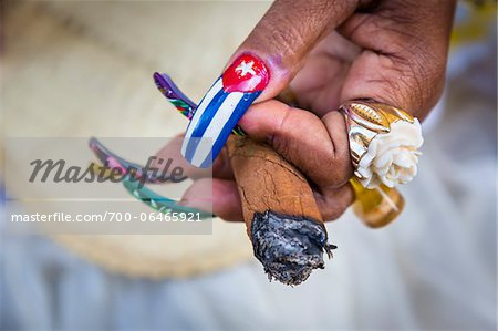 Close-Up of Senora Habana's Hands with Painted Fingernails and Holding Cigar, Plaza de la Catedral, Havana, Cuba Stock Photo - Rights-Managed, Image code: 700-06465921
