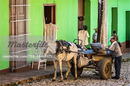 Man with Horse Drawn Cart in front of Green Building, Trinidad, Cuba Stock Photo - Rights-Managed, Image code: 700-06465972