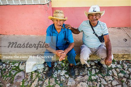 Portrait of Two Men Sitting on Curb and Smoking Cigars, Trinidad, Cuba Stock Photo - Rights-Managed, Image code: 700-06465974