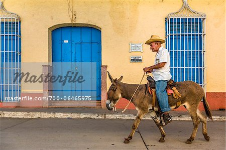 Man Riding Donkey, Trinidad, Cuba Stock Photo - Rights-Managed, Image code: 700-06465975