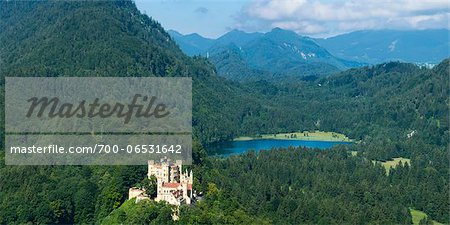 Panoramic View of Hohenschwangau Castle with Lake and Mountains in Background, Fussen, Ostallgau, Bavaria, Germany Stock Photo - Rights-Managed, Image code: 700-06531642