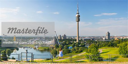 Olympiapark, constructed for the 1972 Summer Olympics, with Olympiaturm in the background, Munich, Oberbayern, Bavaria, Germany