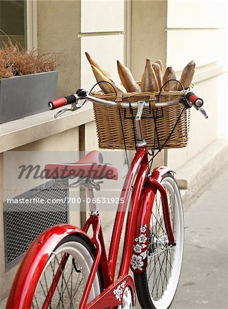 red, classic, road bicycle with wicker basket attached to handlebars filled with baguettes from bakery, Paris, France Stock Photo - Rights-Managed, Image code: 700-06531925