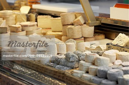 Fresh wedges and rounds of French goat cheese in artisan cheese shop, La Fromagerie, Paris, France Stock Photo - Rights-Managed, Image code: 700-06531958