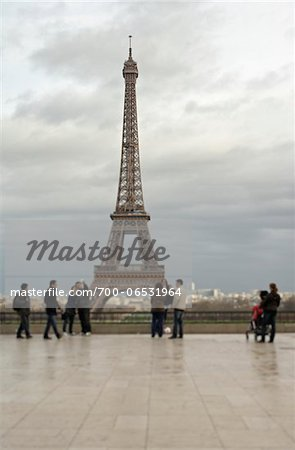 Tourists at the Eiffel Tower in overcast, rainy weather, Eiffel Tower, Paris, France Stock Photo - Rights-Managed, Image code: 700-06531964
