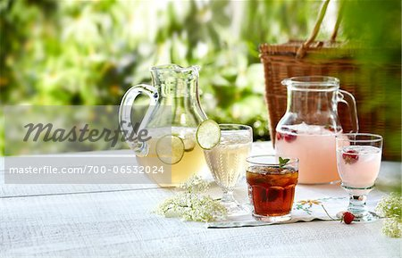 Three summer cordial beverages with mint, lime, and strawberry in an outdoor setting Stock Photo - Rights-Managed, Image code: 700-06532024
