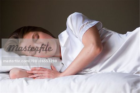 Portrait of sleeping woman on her bed in her bedroom. Stock Photo - Rights-Managed, Image code: 700-06553298