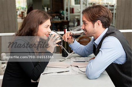 Young Couple in Restaurant Drinking Red Wine Stock Photo - Rights-Managed, Image code: 700-06553385