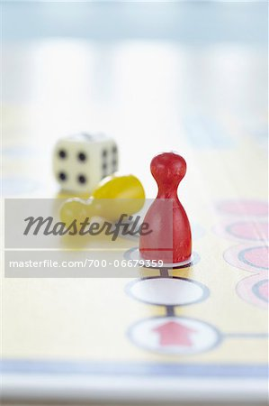 close-up of ludo board game with colored playing pieces and dice Stock Photo - Rights-Managed, Image code: 700-06679359
