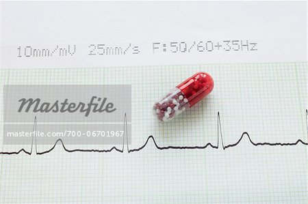 close-up of an electrocardiogram report and a red pill capsule Stock Photo - Rights-Managed, Image code: 700-06701967