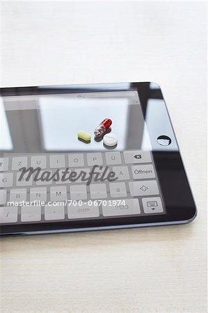 still life of a tablet pc and pills Stock Photo - Rights-Managed, Image code: 700-06701974