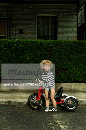 Boy with Bicycle on Neighbourhood Street Stock Photo - Rights-Managed, Image code: 700-06758131