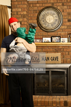 Father and Son Playing by Fireplace in Man Cave Stock Photo - Rights-Managed, Image code: 700-06758135