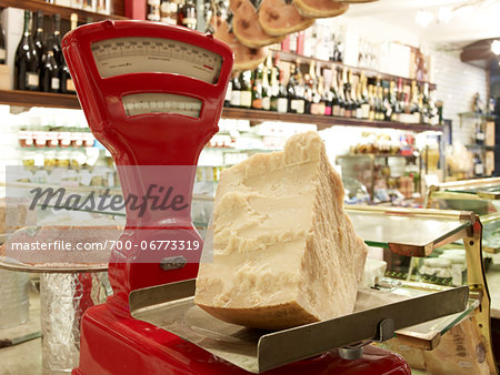 large wedge of parmesan cheese on red antique weigh scale in specialty meat and antipasto shop, Modena, Italy Stock Photo - Rights-Managed, Image code: 700-06773319