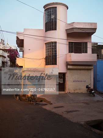 Street view with cow at dusk in old quarter of Binda, India Stock Photo - Rights-Managed, Image code: 700-06782157