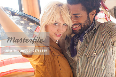 Couple wrapped in an American flag, Portland Oregon USA Stock Photo - Rights-Managed, Image code: 700-06786688