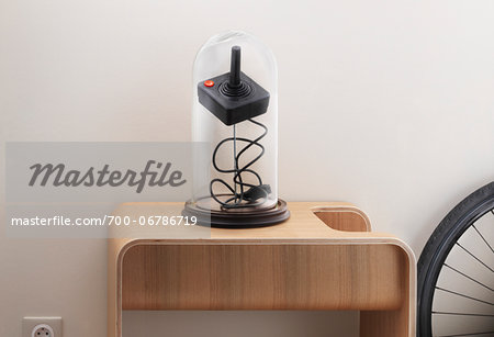 iconic joystick under glass cover on wooden table Stock Photo - Rights-Managed, Image code: 700-06786719