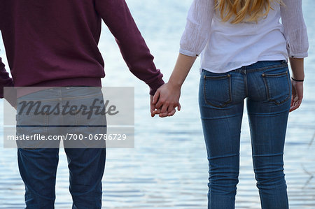 Young couple holding hands by lake, Bavaria, Germany Stock Photo - Rights-Managed, Image code: 700-06786729