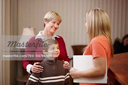 Young boy with mother being greeted by dental hygienist at dentist office Stock Photo - Rights-Managed, Image code: 700-06786949