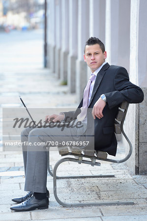 Young Businessman with Laptop Sitting on Bench, Bavaria, Germany Stock Photo - Rights-Managed, Image code: 700-06786957
