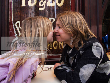 Mother and daughter nose-to-nose on terrace of french cafe, Paris, France Stock Photo - Rights-Managed, Image code: 700-06808775