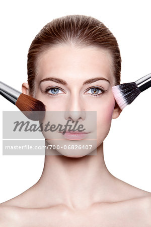 Close-Up of Young Woman Applying Make-Up with Brushes on White Background Stock Photo - Rights-Managed, Image code: 700-06826407